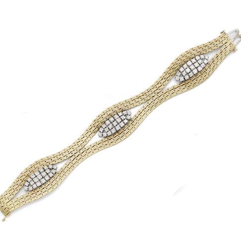 A gold and diamond-set bracelet