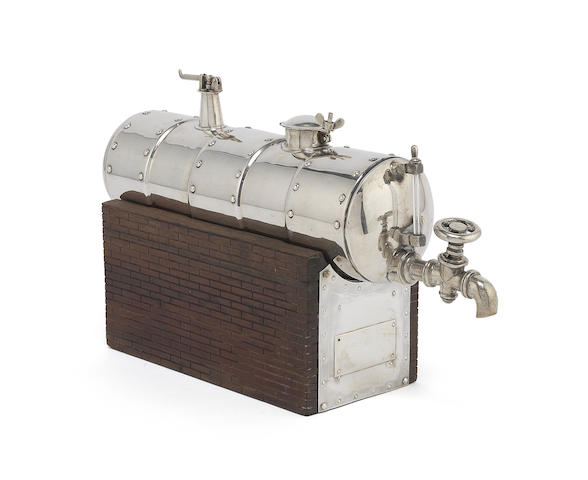 INDUSTRIAL INTEREST: A 19th century unmarked silver flask modelled as a boiler
