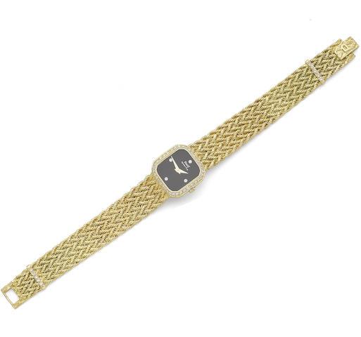 A gold and diamond-set wrist watch