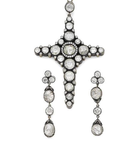 A diamond cross pendant and earrings