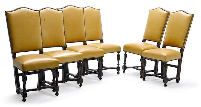 A set of six Continental Baroque walnut dining chairs