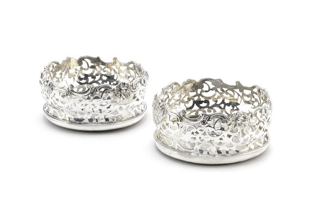 A pair of early Victorian silver coasters