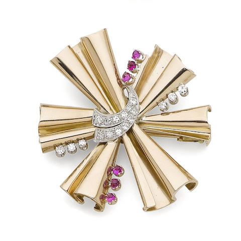 A ruby and diamond starburst brooch