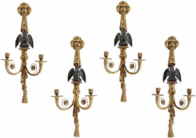A set of four Neoclassical style gilt bronze, parcel ebonized and giltwood two light wall sconces