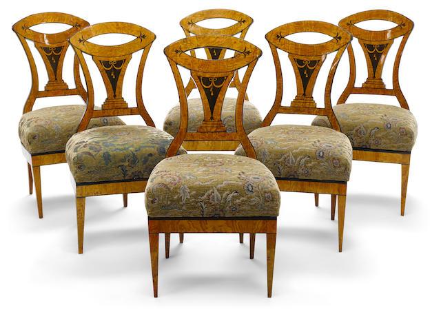 A set of six Biedermeier parcel ebonized elm side chairs