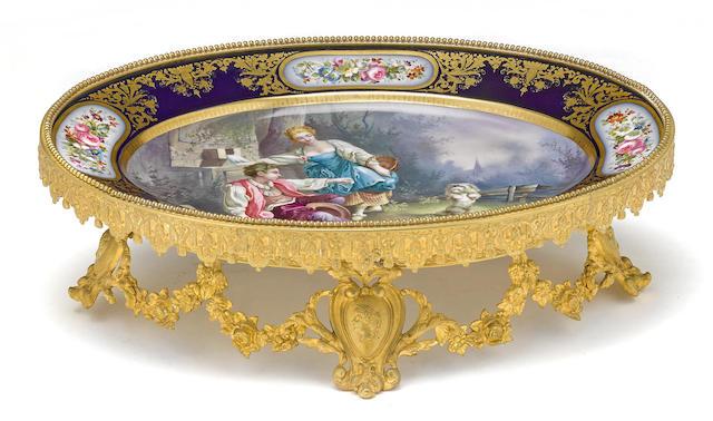 A Sèvres style porcelain gilt bronze mounted centerpiece