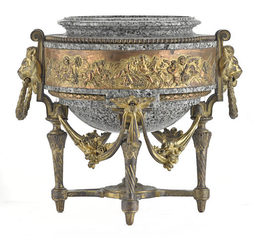 A Neoclassical style gilt and copper plated bronze and granite jardinière