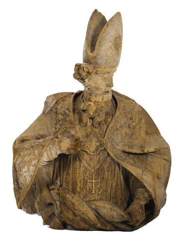 A Continental Baroque parcel paint decorated carved limewood bust of a bishop