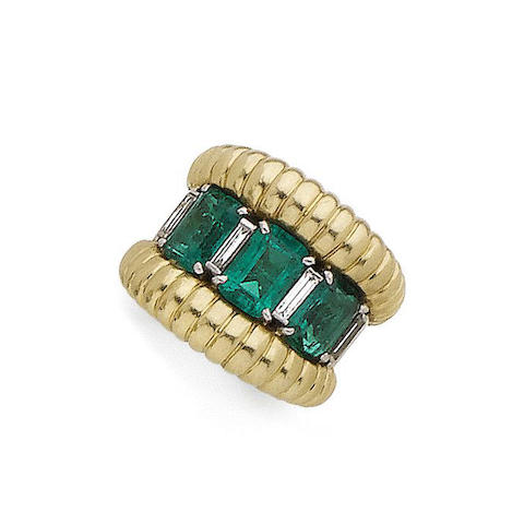 A three-stone emerald cluster ring