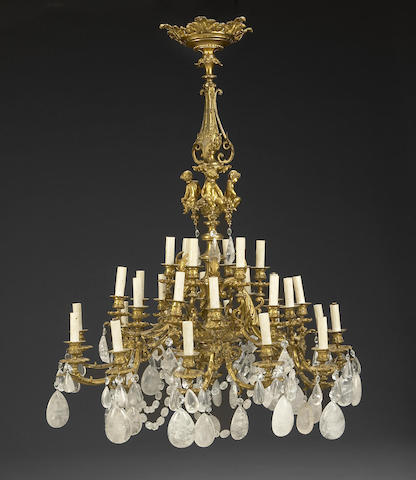 A Régence style gilt bronze and rock crystal thirty light chandelier