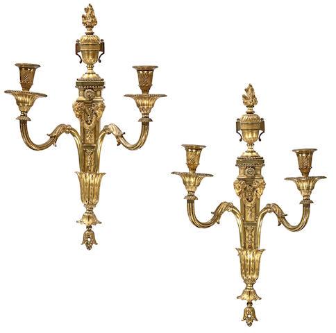 A pair of Louis XVI style gilt bronze two light bras de lumière