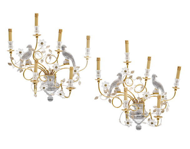A pair of gilt, silvered metal and glass six light wall sconces