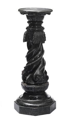 A carved serpentine pedestal