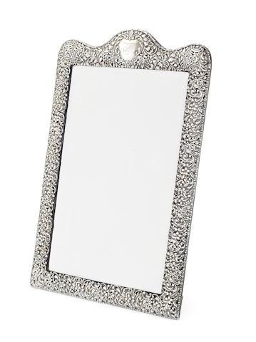An Edwardian silver dressing table mirror