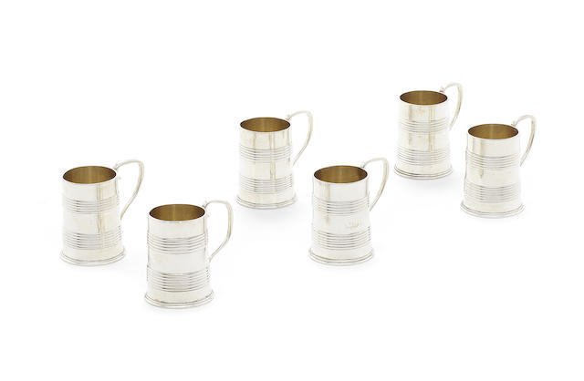 A set of Victorian silver miniature / toy mugs