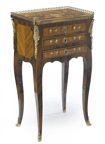 A Louis XV/XVI gilt bronze mounted marquetry table en chiffonière