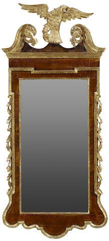 A George II style parcel gilt walnut mirror