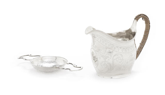 A George II silver lemon strainer
