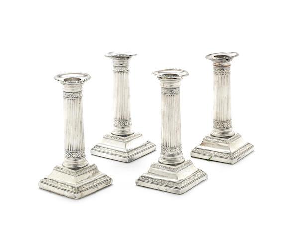 Four George III silver dwarf candlesticks