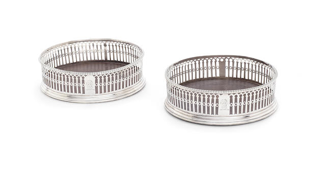 A pair of George III silver coasters