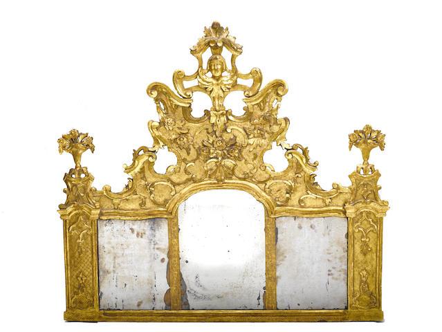 An Italian Rococo carved giltwood mirror