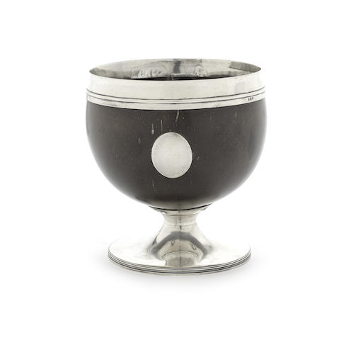 A George III silver mounted coconut cup