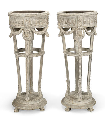 A pair of Louis XVI style paint decorated carved wood jardinières