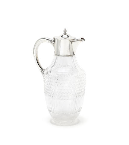 A Victorian silver mounted glass claret jug