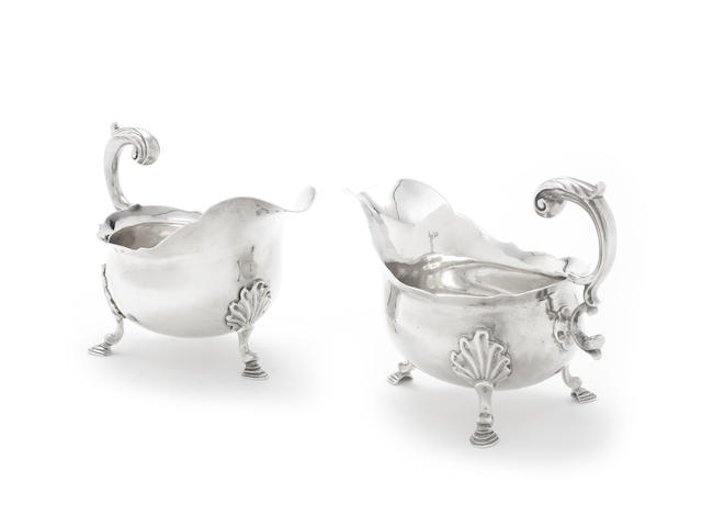 A pair of George II silver sauce boats