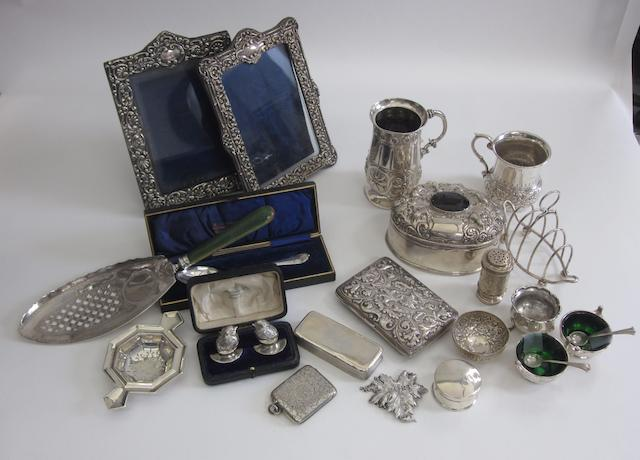 A pair of silver chick and egg menus holders