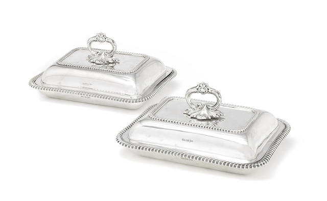 Two silver entrée dishes and covers