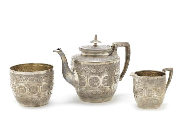 A Scottish silver three-piece Zodiac tea service