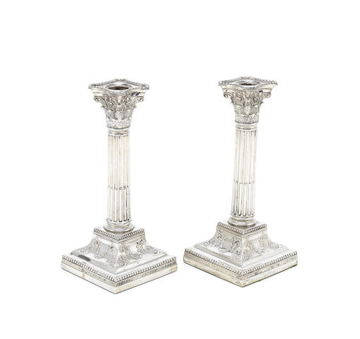 A pair of Victorian silver candlesticks
