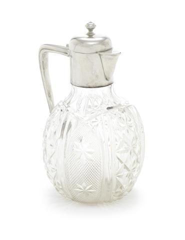 An Edwardian silver mounted glass claret jug