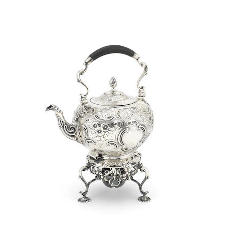 An 18th century Irish silver tea kettle on an English provincial stand