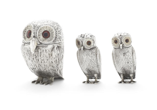 A Victorian silver three-piece novelty owl condiment set, with a mustard pot and two peppers