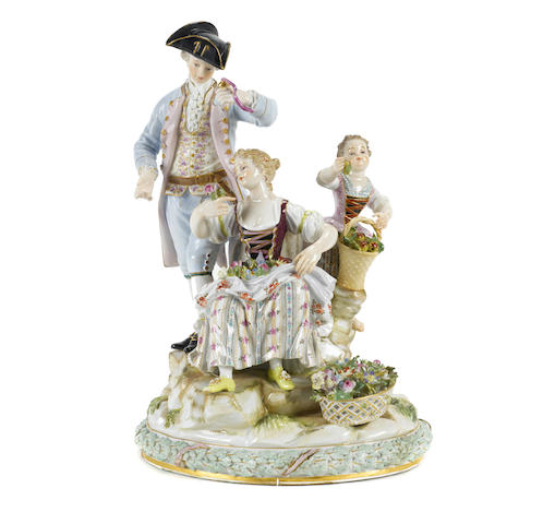 A Meissen porcelain figural group of three figures gathering fruit and flowers