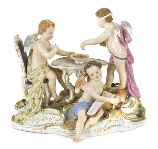 A Meissen porcelain figural group of three putti at a games table