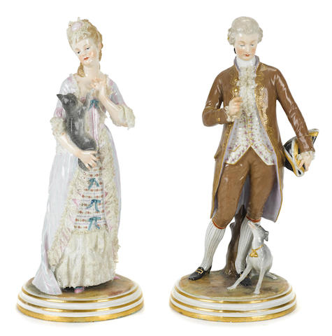 A pair of Meissen porcelain figures of a gentleman and lady