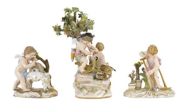 Three Meissen porcelain figures of putti at work