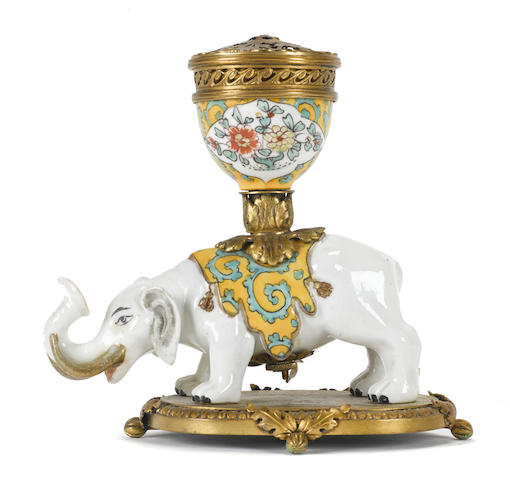 A French gilt metal and porcelain pot pourri supported on the back of an elephant