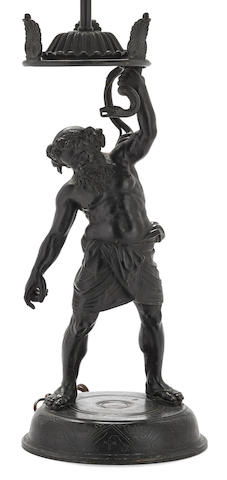 A Continental patinated bronze figure of Silenus after the antique