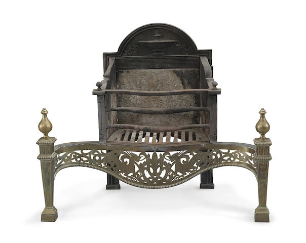 A George III engraved brass and cast iron fire grate