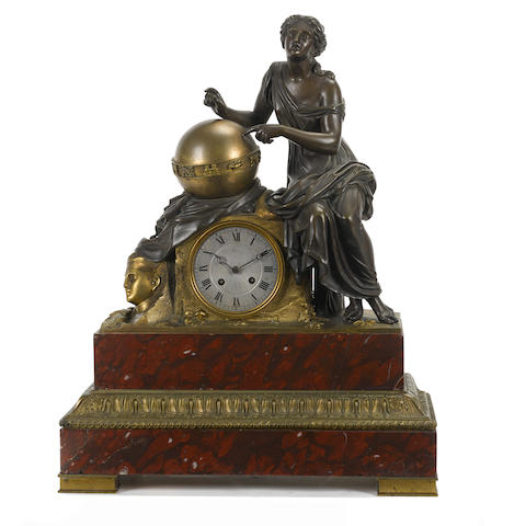 A French gilt and patinated bronze and rouge marble mantel clock