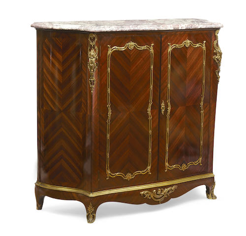 A French gilt bronze mounted kingwood and mahogany meuble d'appui