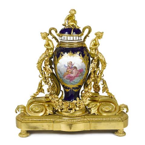 A good quality French porcelain and gilt bronze rotary mantel clock