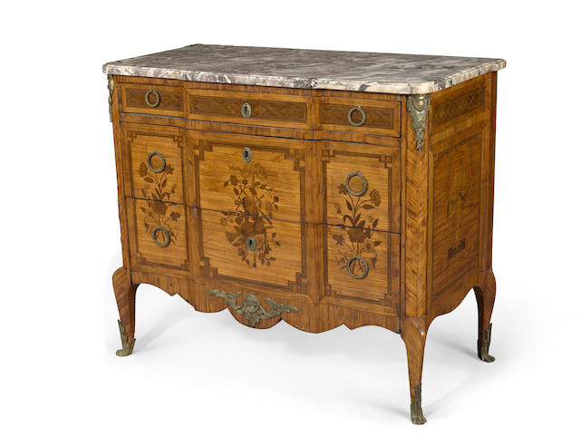 A Louis XV/XVI Transitional style gilt bronze mounted marquetry inlaid commode