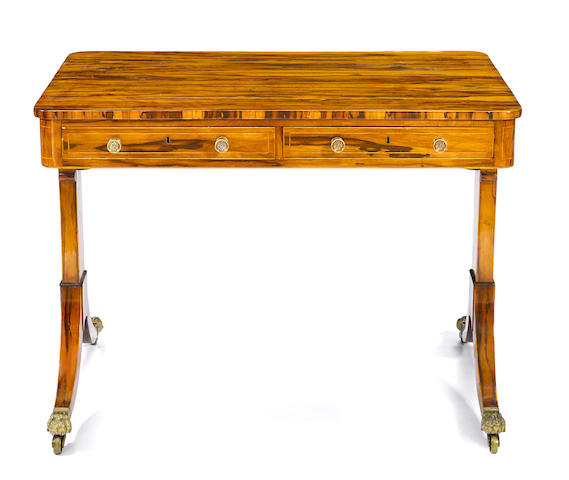 A Regency boxwood lined calamander writing table