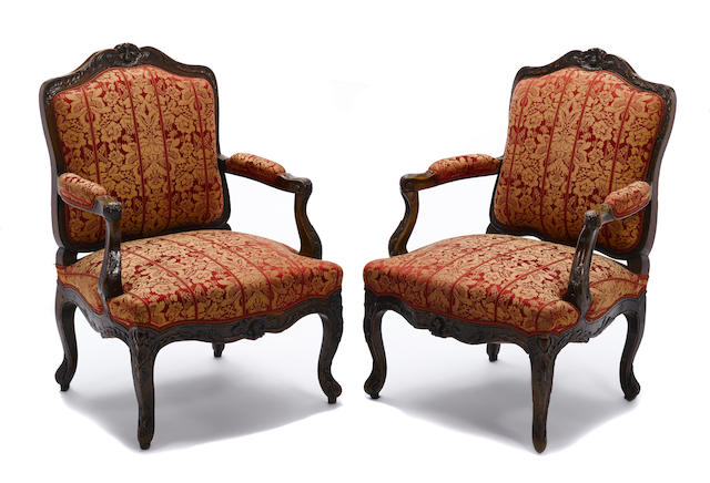 A pair of Louis XV style beechwood fauteuils