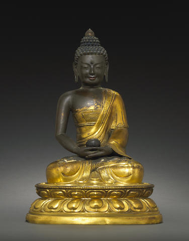 A large gilt copper alloy figure of Buddha